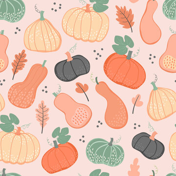 Seamless pattern with colorful leaves and pumpkins