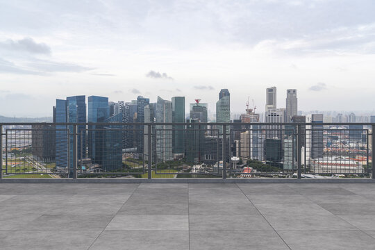 Panoramic Singapore skyline view, concrete observatory deck on rooftop, daytime. Asian corporate and residential lifestyle. Financial city downtown, real estate. Product display mockup empty roof