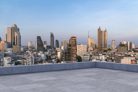 Panoramic Bangkok skyline view, concrete observatory deck on rooftop, sunset. Luxury Asian corporate and residential lifestyle. Financial city downtown, real estate. Product display mockup empty roof