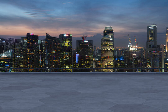 Panoramic Singapore skyline view, concrete observatory deck on rooftop, night time. Asian corporate and residential lifestyle. Financial city downtown, real estate. Product display mockup empty roof