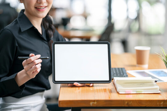 woman hand holding and showing blank screen portable tablet.